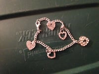 copper-colored chain bracelet with heart charms