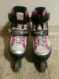pair of black-and-pink inline skates Surrey, V3W 1R9