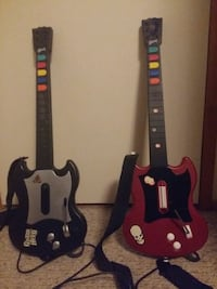 two black and red Guitar Hero controllers Port Coquitlam, V3B 5G8