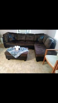 Brown sofa & it comes with the the center table
