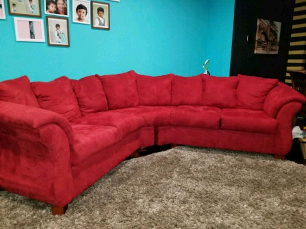 red fabric sectional sofa with throw pillows