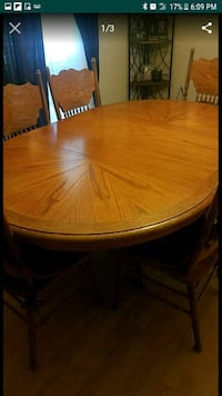 round brown wooden table with chairs Bedford, 76022