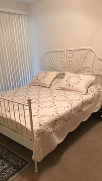King size bed with mattress. almost new
