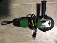 black and green angle grinder