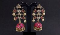 pair of silver-colored earrings 546 km