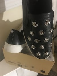 Pair of black michael kors leather slip-on shoes