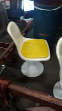 white and yellow tulip 4 chair set