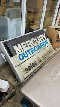 Old mercury outboard marine sign