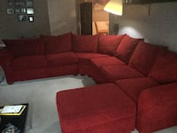 red fabric sectional sofa with ottoman null