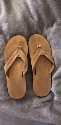 pair of brown suede flip-flops Fort Lauderdale, 33301