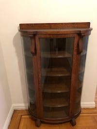 Brown wooden framed glass display cabinet New York