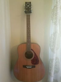 brown and black acoustic guitar Costa Mesa, 92626
