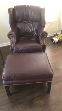 All leather wing back chair and ottoman  Berlin, 08009