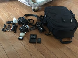 Brand New HD Camcorder, Digital SLR body and lens and backpack