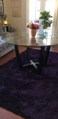 Round glass top table with black wooden base Louisville, 40206