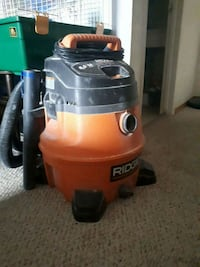 red and black Ridgid wet / dry vacuum cleaner Calgary, T2C 0Z7
