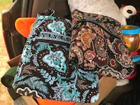 two brown and blue floral, red and black floral quilted handbags