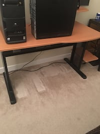 black and brown wooden computer desk
