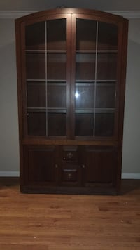 brown wooden framed glass display cabinet Houston, 77075
