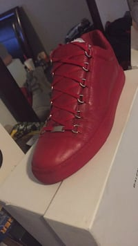 unpaired red leather high-top sneaker Calgary, T1Y 4X9