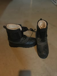 pair of gray-and-black leather duck boots