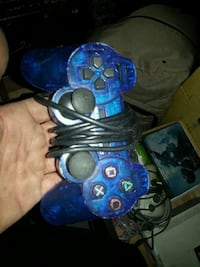 blue and black Sony PS2 controller Edmonton, T5W