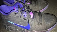 Pair of gray-and-purple nike basketball shoes