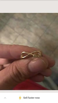 Gold colored infinity love ring
