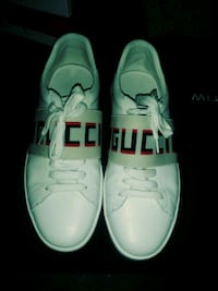 pair of white low-top sneakers Gulfport