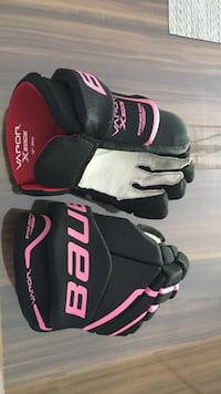 pair of pink-and-black Bauer gloves Terrebonne, J7M 2C3
