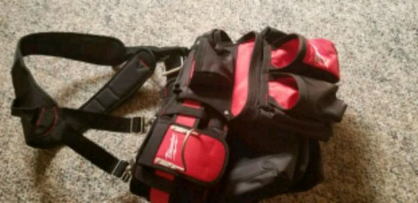black and red duffel bag