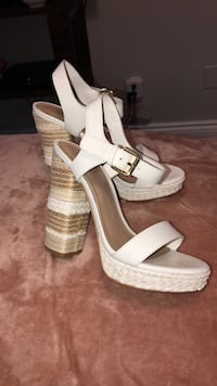 pair of white leather open toe wedges
