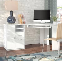 White computer desk. Almost brand new. Sells new for $300 on Wayfair. We have it in two pieces for easy transport. Needed to make room for a nursery so why we're selling. Like new condition and already assembled! Fredericksburg, 22401