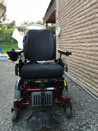 "Black and red motorized power wheelchair from sunrise medical Quickie experience in very good condition and perfectly function size 18""X18"" Mississauga, L4T 1T9"