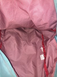 Teal Hershel backpack with red and white interior (two pockets) Windsor, N9B 2N8