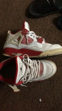 pair of white-and-red Air Jordan 4 Washington, 20024