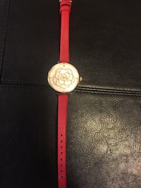 Kate Spade Metro Rose Watch with red leather strap.