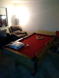 brown wooden pool table with cue sticks Savannah, 31406