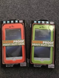 two orange and green WaterProof heavy duty case boxes