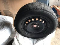 black bullet hole car wheel with tire Kitchener, N2E