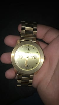 round gold-colored Nixon analog watch with link bracelet Palm Bay, 32907