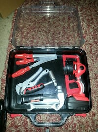 red and black cordless power tool set in case