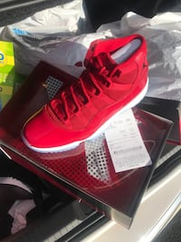 Unpaired red air jordan 11 shoe