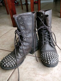 pair of black leather cap-toe silver studded comba Calgary, T1Y 5K3