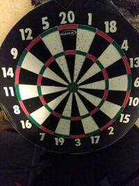 Dart board with baseball on other side