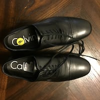 pair of black leather dress shoes 39 km