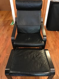 Real black leather chair with leg rest