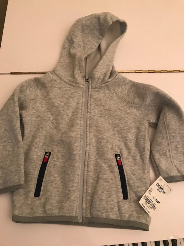 New with tag Gray zip-up hoodie 18 Months.