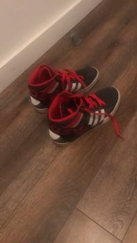 Pair of red-and-black adidas sneakers Gatineau, J8X 2M2
