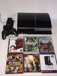 black Sony PS3 super slim console with game cases Amherst, 03031